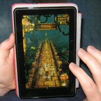 Husband Playing Temple Run on Amazon Kindle Fire