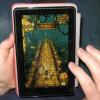 Husband Playing Temple Run on Amazon Kindle Fire
