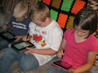 Three Niece and Nephews Playing on Kindle Fires