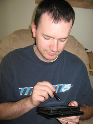 My husband playing on his Kindle Fire