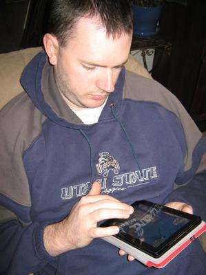 My husband playing on my Kindle Fire